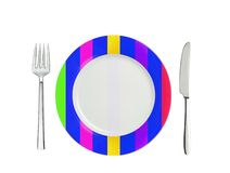 Knife, striped colorful plate and fork, isolated on white Royalty Free Stock Photo