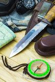 Knife surrounded by tourist equipment Royalty Free Stock Image