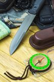 Knife surrounded by tourist equipment Royalty Free Stock Photography