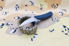 Knife and survival bracelet. Royalty Free Stock Photo
