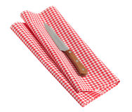 Knife on a tea towel Royalty Free Stock Images