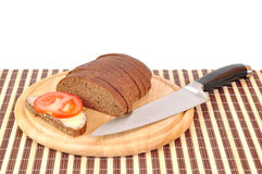 Knife tomato bread Stock Photography