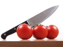 Knife and tomatos Royalty Free Stock Photo