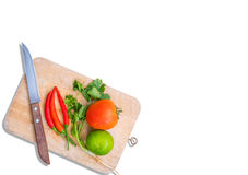 Knife and various kinds of fresh vegetables Royalty Free Stock Image