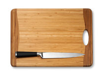 Knife on vintage cutting board Royalty Free Stock Images