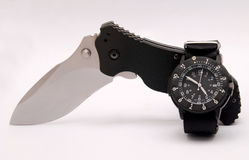 Knife and watch royalty free stock photography