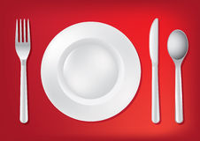 Knife, White Plate And Fork Royalty Free Stock Photo