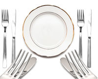 Knife, white plate and fork Royalty Free Stock Images
