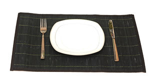 Knife, white plate and fork Stock Image