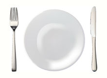 Knife, white plate and fork isolated Royalty Free Stock Image