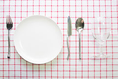 Knife white plate and fork spoon Stock Images