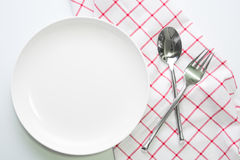 Knife white plate and fork spoon Royalty Free Stock Photography
