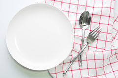 Knife white plate and fork spoon Royalty Free Stock Image