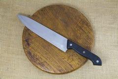 Knife on wooden block Stock Photos