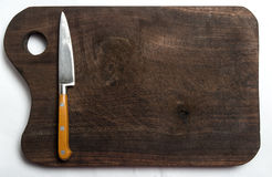 Knife on a wooden board royalty free stock photos