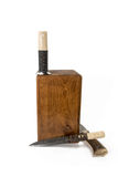 Knife in a Wooden Box Stock Photos