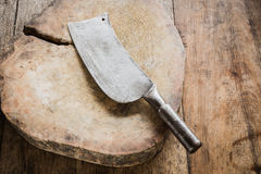 Knife on a wooden butcher Stock Images