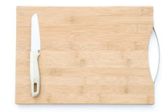 Knife on a wooden chopping board Stock Photo