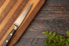 Knife on wooden chopping board. With copy space royalty free stock photo