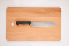 Knife and  wooden chopping board Royalty Free Stock Images