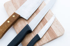 Knife on wooden chopping board Stock Photos