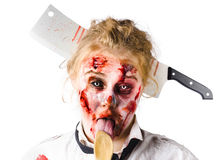 Knifed woman licking spoon Stock Photography