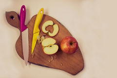 Knifes and sliced apples Stock Photo