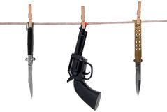Knifes and toy gun hanging on Royalty Free Stock Image