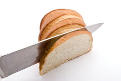 Knifing piece of bread. Cutting a slice from the loaf Royalty Free Stock Image