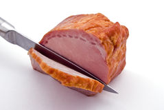 Knifing piece of meat. Separable a piece of meat Stock Photos