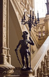 Knight. Metal statue of a knight at the grand staircase in the old house Royalty Free Stock Photography