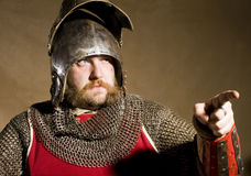 Knight. Serious medieval knight studio shot Royalty Free Stock Images