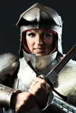 Knight. Portrait of a medieval female knight in armour over black background Royalty Free Stock Image