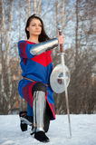 Knight. Girl in armor with a sword knight stock photography