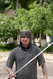 A knight. Poses in a summer park Stock Photos