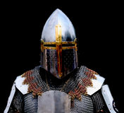 Knight. Armored knight on black background Stock Image