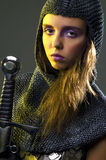 Knight. Photo of woman knight ready to fight Royalty Free Stock Image