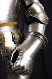 Knight. Armour of the medieval knight. Metal protection of the soldier against the weapon of the opponent Stock Images