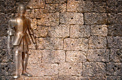 Knight against ancient stone wall Royalty Free Stock Images