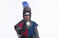 Knight annoyed with smartphone, horizontal Stock Image
