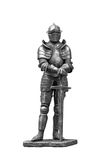 Knight in armor. The figure of a knight in steel armor on a white background royalty free stock images