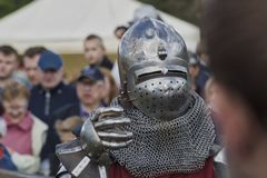 Knight in armor with a metal glove stock images