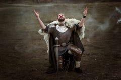 Knight in armor pray. Royalty Free Stock Photo