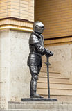 Knight in armor with a sword. The figure of a knight in steel armor royalty free stock photos