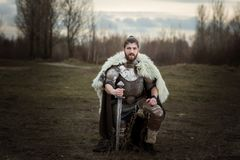 Knight in armor with a sword in his hands. Stock Photography