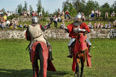 Knight in armor on the tournament Stock Photos