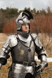 Knight in armour after battle on forest background. Knight before battle. Close up. Win battle Royalty Free Stock Photo