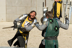 Knight attacking his rival with a sword Royalty Free Stock Photo