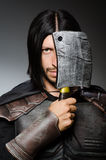 Knight with axe against Stock Photos