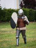 Knight in Battle with Silver Helmet, Armor, Shield and Sword.  Stock Photos